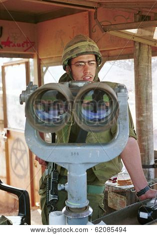 MARJAYOUN - MARCH 22 An Israeli defense force (IDF) soldier looks out over southern Lebanon from an observation post near the Israeli Lebanese border on March 22, 2000.
