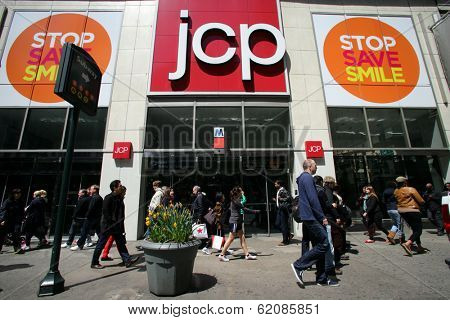 NEW YORK CITY - APRIL 19: Shoppers walk past a J.C. Penny store in New York City, on Friday, April 19, 2013.