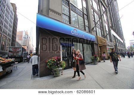 NEW YORK CITY - OCT 17:  Pedestrians walk past a branch of Citibank in Manhattan on Thursday, October 17, 2013.