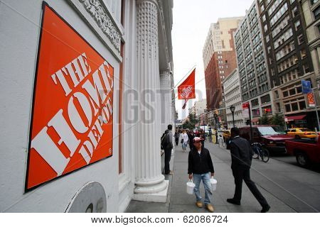 NEW YORK CITY - OCT 23 2013: Shoppers walk past The Home Depot retail home improvement store in Manhattan on Wednesday, October 23, 2013.