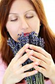 Mature woman smelling lavender flowers focus on hands poster