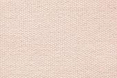 abstract background of light terracotta coarse-grained texture of rough fabric with an interlacing poster