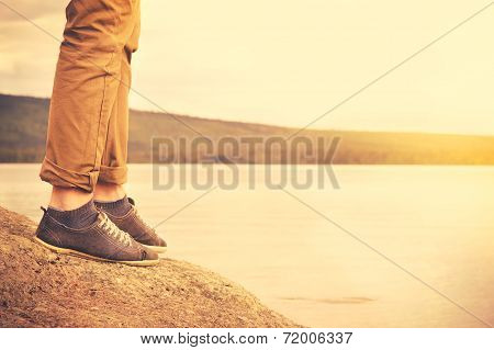 Feet Man Walking Outdoor Travel Lifestyle Vacations Concept With Lake And Sun On Background Retro Co