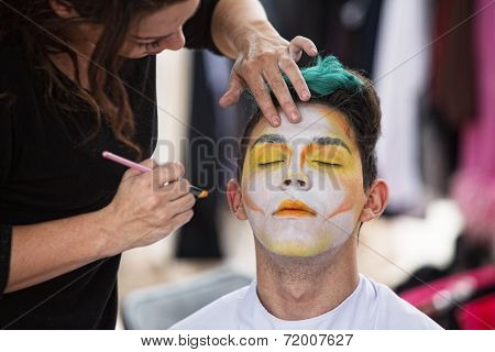 Sylist Putting Makeup On Clown