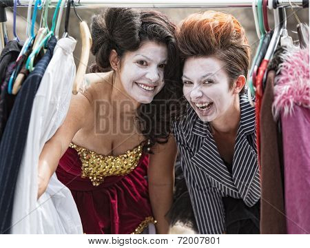 Laughing Clowns At Clothes Rack