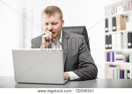 Concerned Businessman Working At His Desk
