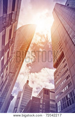 several office towers and buildings in the sun seen from below, Frankfurt am Main, Germany