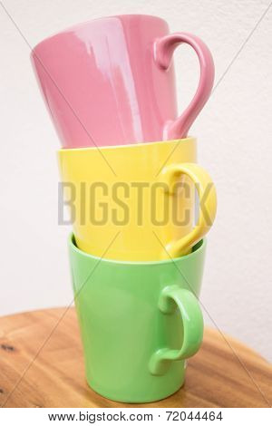 Sweet Color Mug Cups On Wooden Table