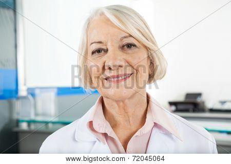 Portrait of confident senior researcher in laboratory