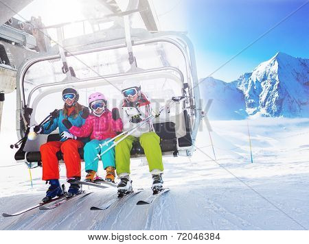 Ski, skiing - skiers on ski lift poster