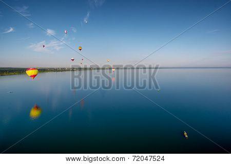 Hot Air Balloons Flying Over Lake.