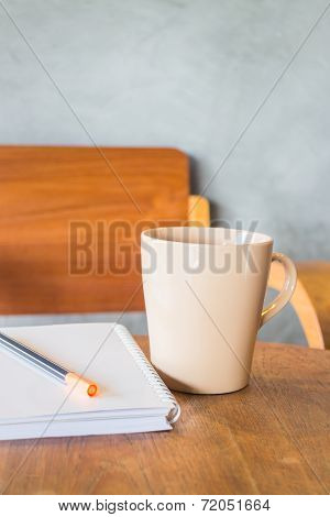 Beautiful Wooden Work Table With Cup Of Coffee
