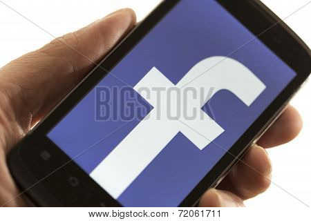 Belgrade - May 15, 2014: Logo Of Popular Social Media Website Facebook On Smart Phone Screen