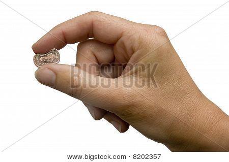 Hand Pinching a British Pound Sterling