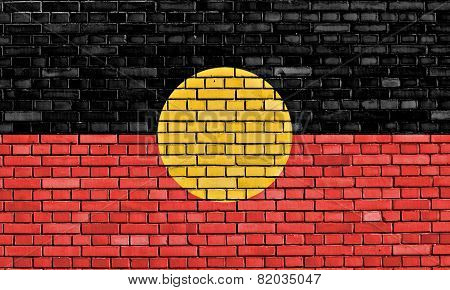 flag of Australian Aboriginal painted on brick wall