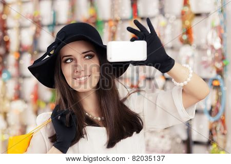 Happy Beautiful Woman Shopping Taking a Selfie