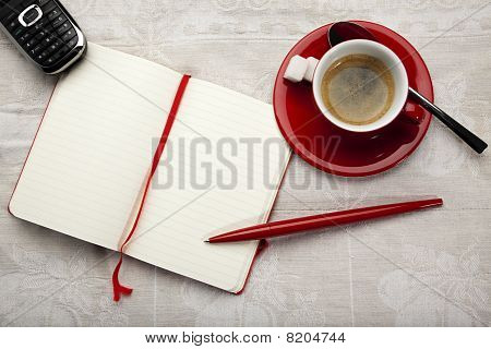 Notebook, Espresso And Telephone