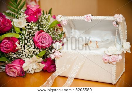 Wedding Rings In The Trunk Next To The Wedding Bouquet Bride