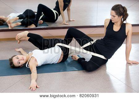 Two Yogi Female Practicing Yoga Therapy In Class