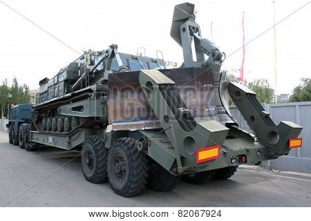An old Soviet Armored troop-carrier on the street Armoured personnel carrier poster