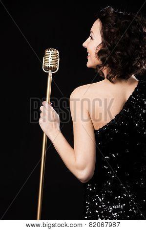 Beautiful Brunette Girl Vocalist Smiling Holding Golden Vintage Microphone