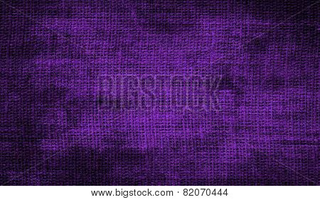 Grunge background of purple fabric texture
