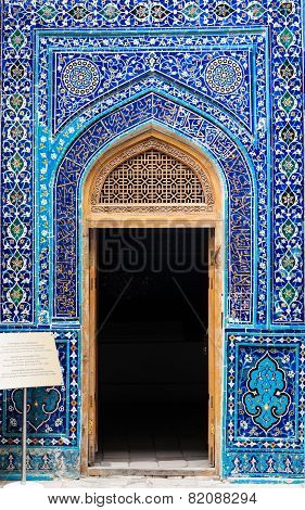 Entrance to mausoleum decorated by oriental traditional ceramic ornament in Samarkand Uzbekistan