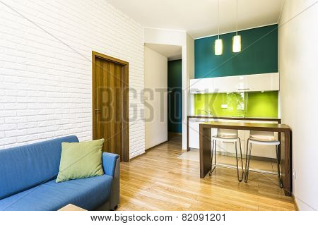 Small Living Room With Green Kitchenette