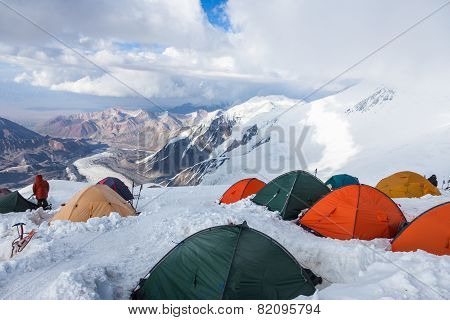 Mountain view from Lenin peak camp 4. Climbers preparing for summit attempt in their tents.