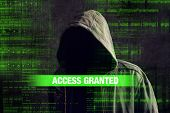 Access granted to Faceless hooded anonymous computer hacker with programming code from monitor poster