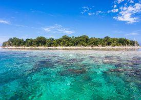 Turquoise ocean water and Idyllic tropical island of Sipadan in Sabah Malaysia.