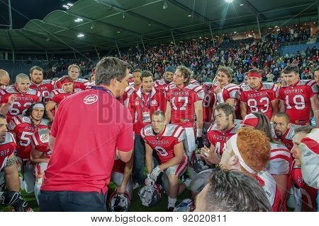 GRAZ, AUSTRIA - MAY 31, 2014: Head Coach Jakob Dieplinger (Austria) talks to his team in the huddle after the  game.