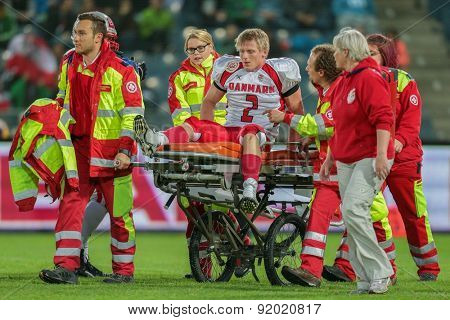 GRAZ, AUSTRIA - MAY 31, 2014: LB Timmi Kleinnibbelink Rysgaard (#2 Denmark) is transported off the field after an injury.