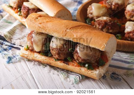 Sandwich With Meatballs And Cheese Close-up On The Table