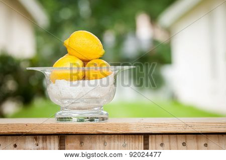 Lemons In A Glass Bowl At A Lemonade Stand