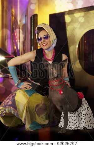 Pinup And Rockabilly Styled Woman With A Dog