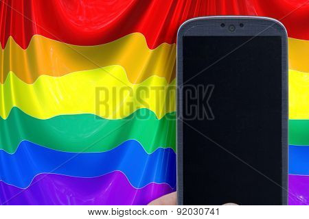 Blue smartphone and LGBT flag background. Idea for Valentines Day messages, LGBT love, lovers, love apps, Internet, blogs and others.
