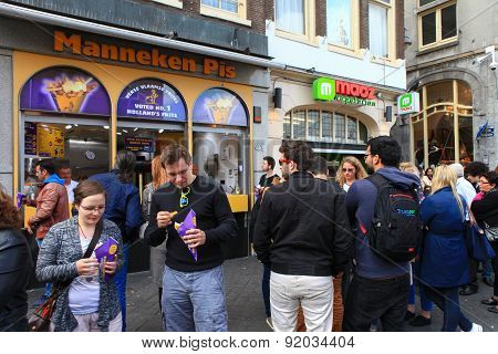 Dutch fries street shop with people