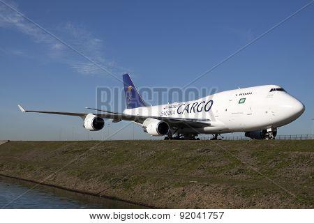 Big white cargo plane on a blue sky