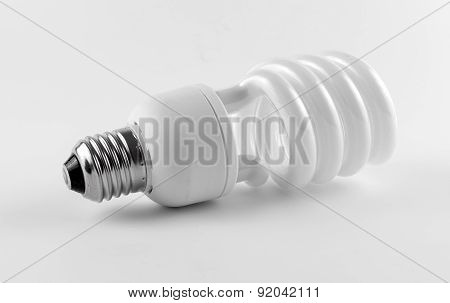 Energy saving fluorescent light bulb on white background