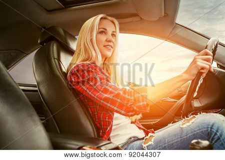 Young Blonde Drives A Car