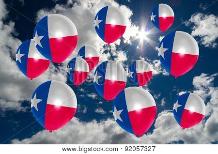 Many Balloons With Texas Flag On Sky