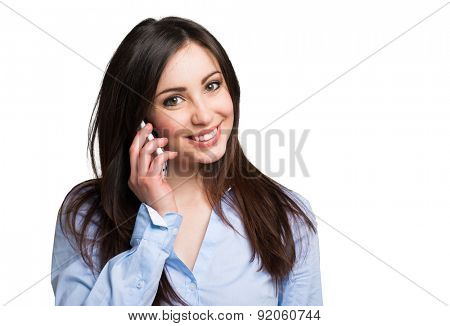 Portrait of a young smiling woman talking on the mobile phone. Isolated on a white background