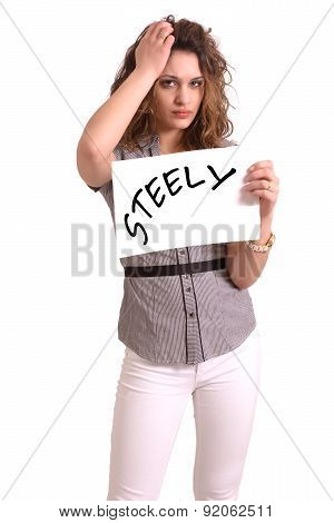 Uncomfortable Woman Holding Paper With Steely Text
