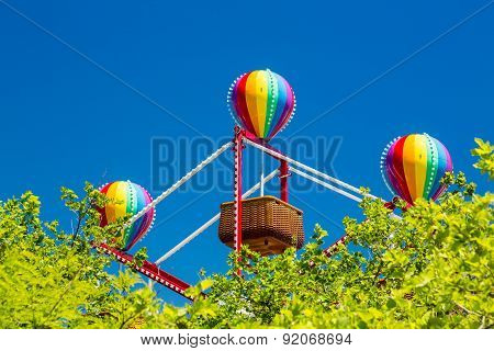 Colorful Balloons On Small Basket Ferris Wheel