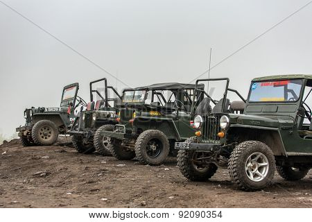 Mount Merapi , Java Indonesia - 15 April 2015 : Jeeps are waiting for their guest to comeback from a walk at parking areas.