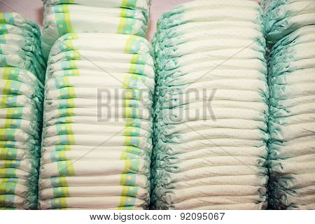 Children's Diapers Stacked In A Many Piles