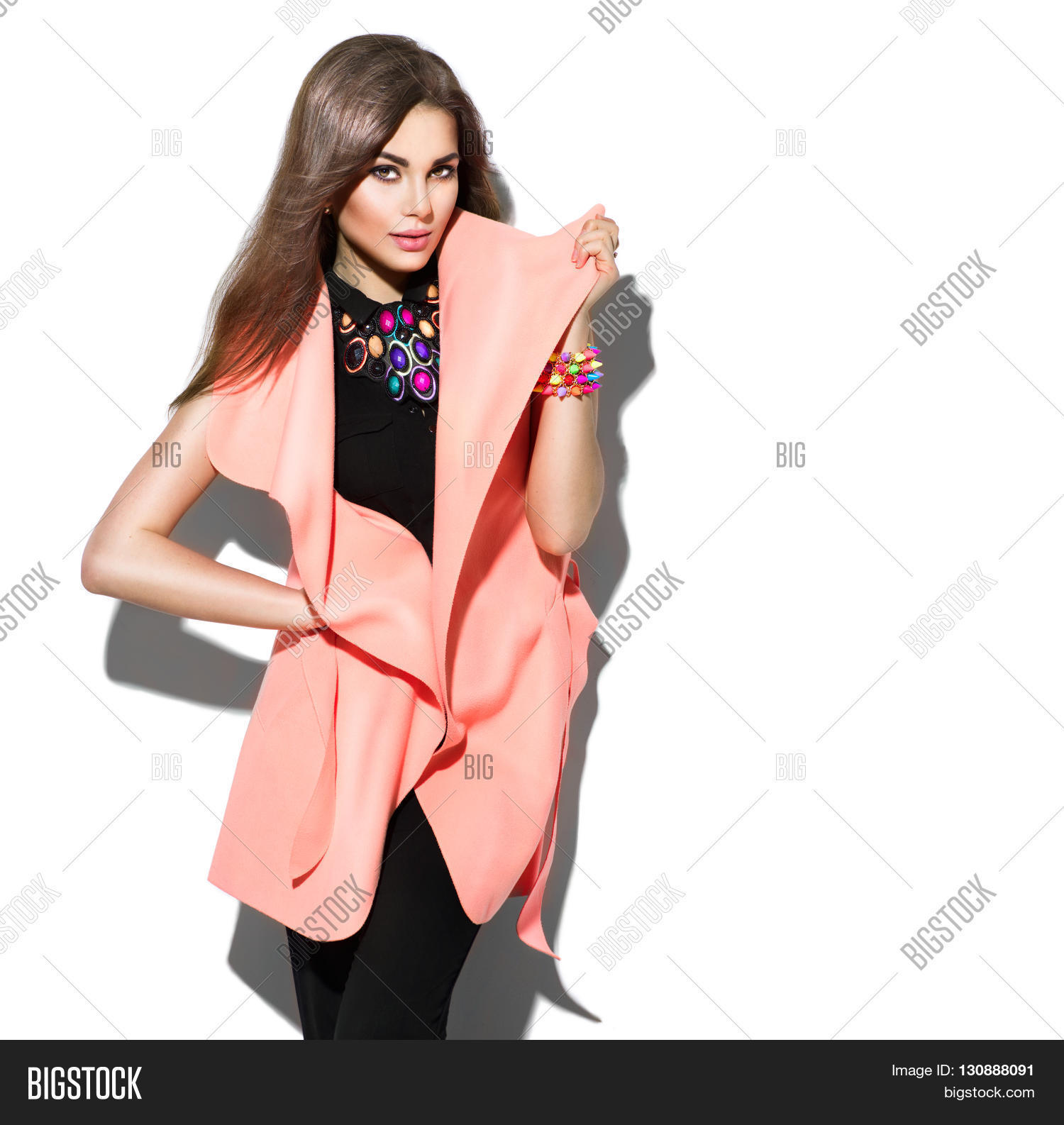 556bf44f048 Fashion Model girl isolated over white background. Beauty stylish brunette  woman posing in fashionable clothes
