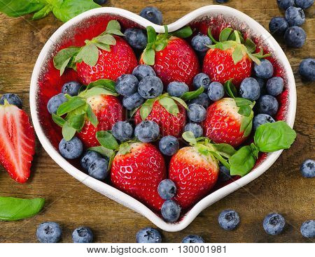 Berries In Heart Shaped Bowl. Healthy Eating Concept.