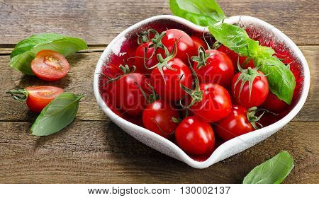 Fresh Tomatoes In A Heart Shaped Plate. Healthy Eating.